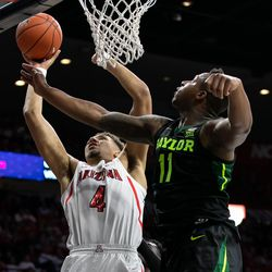 Arizona's Chase Jeter (4) snatches an offensive rebound in the first half of the Arizona-Baylor game in McKale Center on December 15 in Tucson, Ariz.