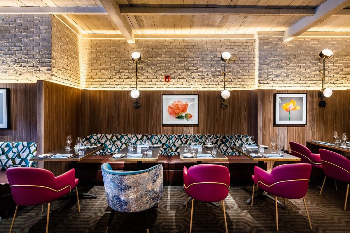 Wood-paneled walls glow where they meet brick in the dining room at Annabelle