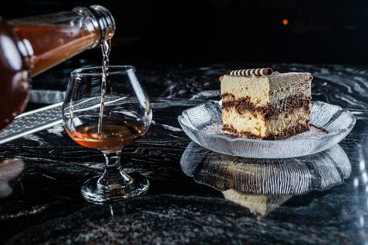 Tiramisu gets served next to homemade digestifs at Caruso's Grocery