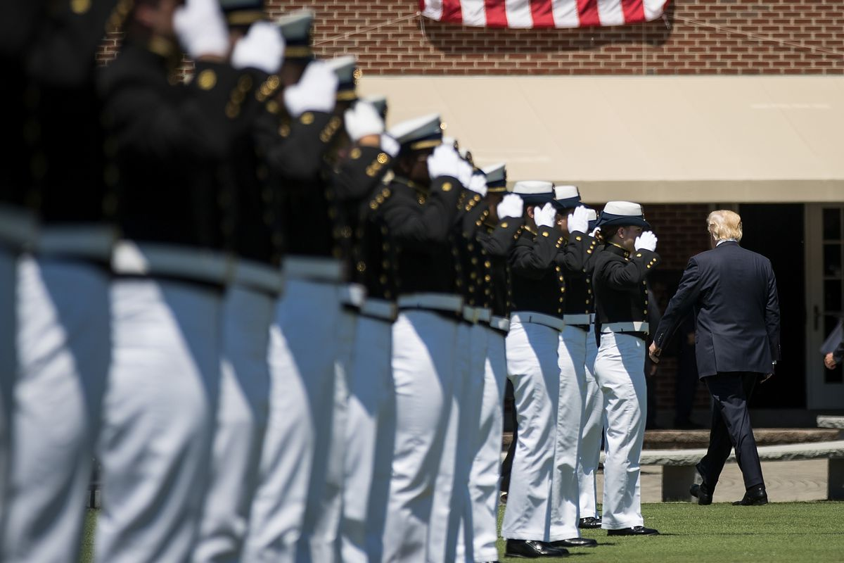 US President Donald Trump walks past members of the U.S. Coast Guard as he exits the commencement ceremony for the U.S. Coast Guard Academy, May 17, 2017 in New London, Connecticut.
