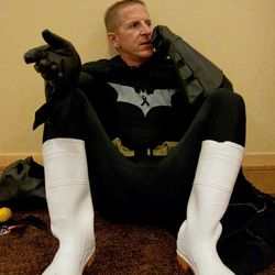 An unidentified man dressed as Batman talks on his mobile phone during a break from the festivities at Dragon Con in Atlanta, on Friday, Aug. 31, 2012. The annual science fiction and fantasy convention drew big crowds and had more than 30,000 pre-registered attendees.