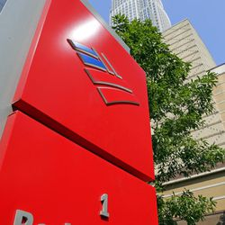 FILE - This Tuesday, July 7, 2015, file photo, shows Bank of America's corporate headquarters in Charlotte, N.C. Buffett's Berkshire Hathaway is buying 700 million shares in Bank of America, making Buffett the largest shareholder in two of the nation's largest banks.