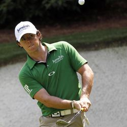 Rory McIlroy, of Northern Ireland, chips to the 13th green during a practice round for the Masters golf tournament Wednesday, April 4, 2012, in Augusta, Ga.