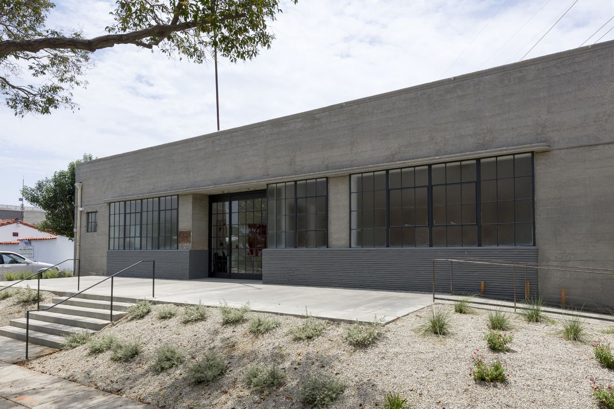 Concrete building with dry landscaping