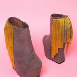 The heeless platform is bold enough, but gold fringe take the Moks Fringe wedge booties to the next level. $83.93 (sale)