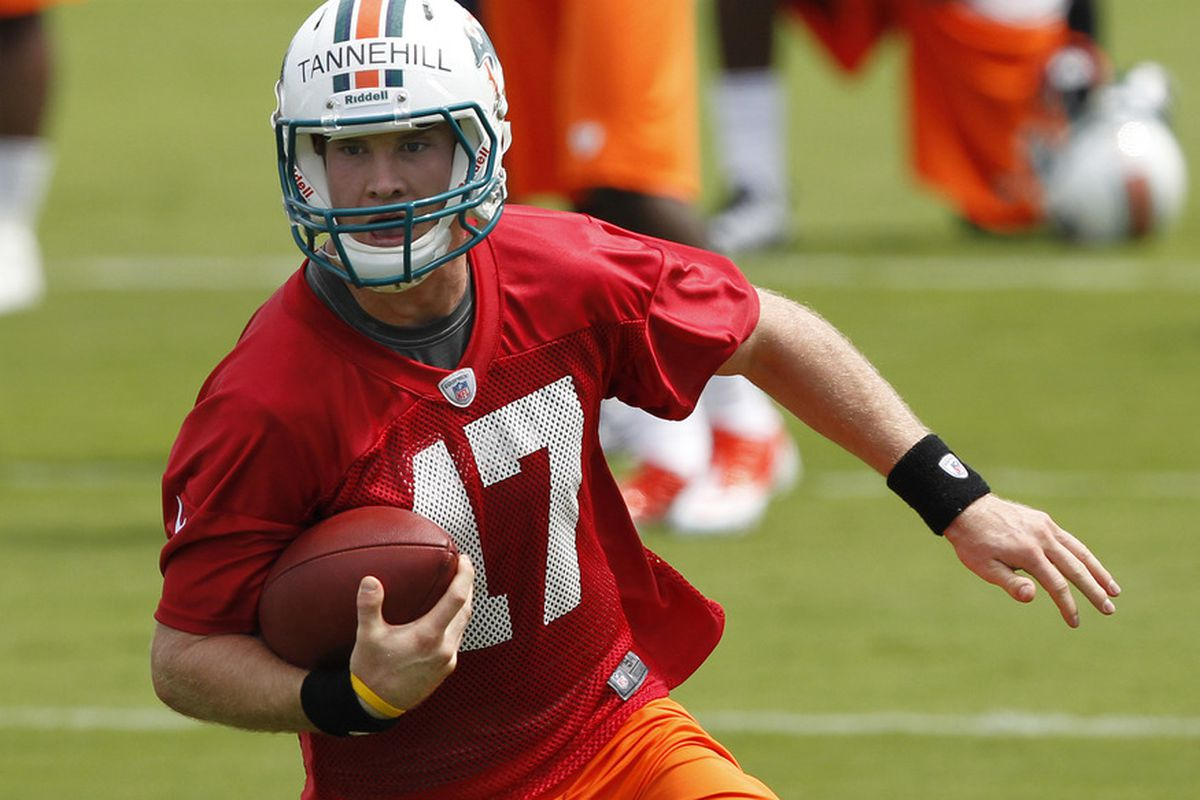 DAVIE, FL - MAY 4:  Ryan Tannehill #17 of the Miami Dolphins runs with the ball during the rookie minicamp on May 4, 2012 at the Miami Dolphins training facility in Davie, Florida. (Photo by Joel Auerbach/Getty Images)