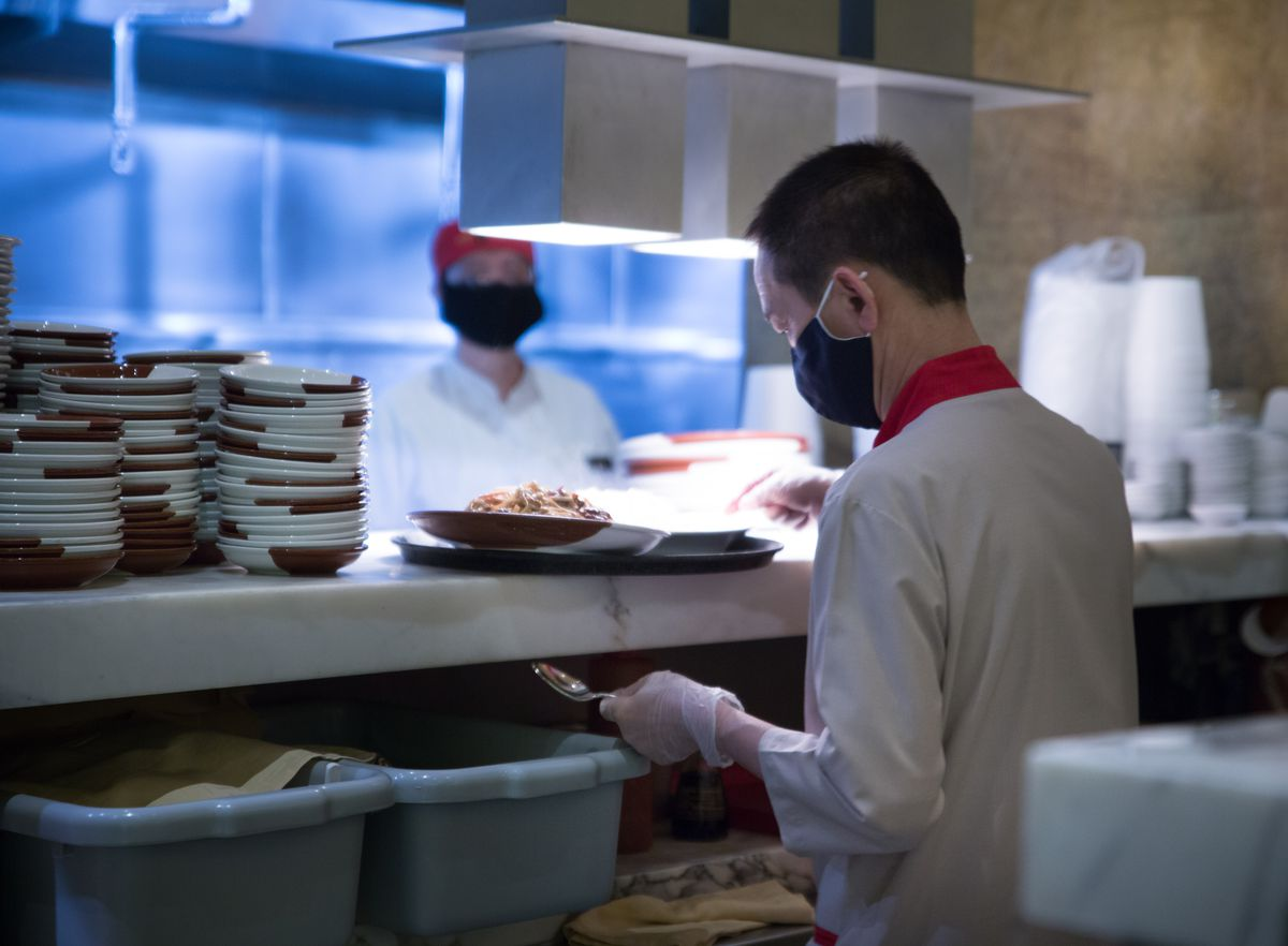 A chef expedites dishes at Noodles at the Bellagio