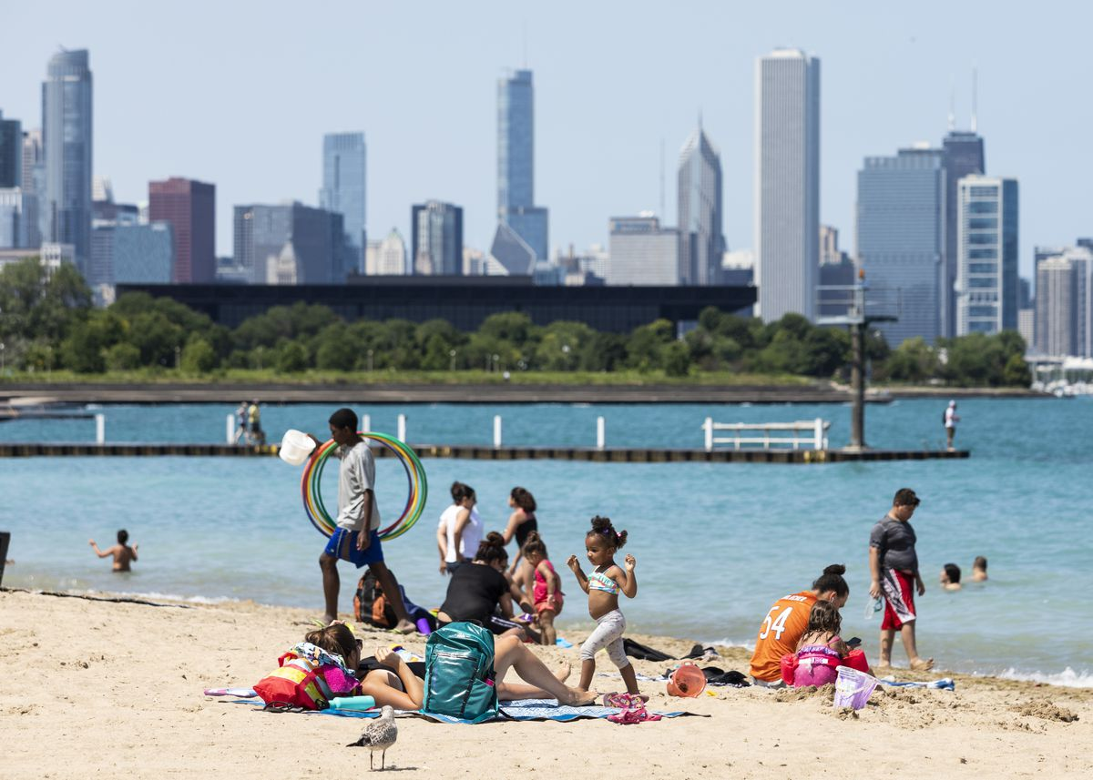 People enjoy the weather at 31st Street Beach on the South Side, Wednesday afternoon, July 24, 2019.