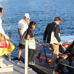 Attendees board the taxi boat