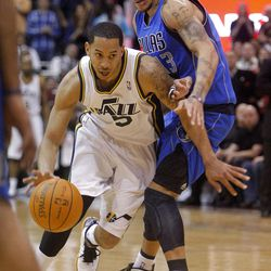 Utah Jazz guard Devin Harris (5) drives past Dallas Mavericks guard Delonte West (13) as the Utah Jazz and the Dallas Mavericks play Monday, April 16, 2012 in Salt Lake City.