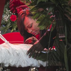 """LaTonya Jones kisses her mother, Bettie Jones, who was """"accidentally"""" shot to death by a Chicago Police officer the day after Christmas, during her funeral at New Mount Pilgrim Missionary Baptist Church on Wednesday, Jan. 6, 2016."""