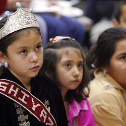 Aiyana McCabe, Kalani McCabe and Tinisha Quintana listen to a story during Navajo Winter Stories night in Salt Lake City.