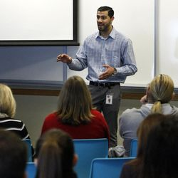 Sail Oberoi of the Utah Division of Workforce Services talks at a volunteer orientation during a volunteer open house event at the Utah Refugee Education and Training Center in Salt Lake City, Saturday, Jan. 9, 2016.