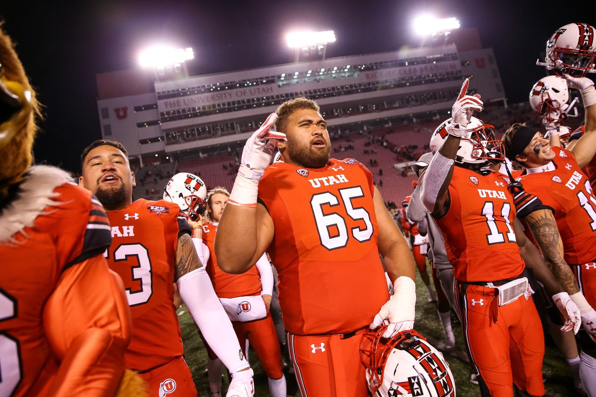 Utah Utes offensive lineman Paul Toala (65) and teammates celebrate after their 42-10 win over the Arizona Wildcats at Rice-Eccles Stadium in Salt Lake City on Friday, Oct. 12, 2018.