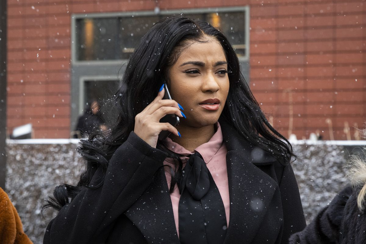 Joycelyn Savage, one of R. Kelly's girlfriends, walks out of the Cook County Domestic Violence Courthouse on Thursday.