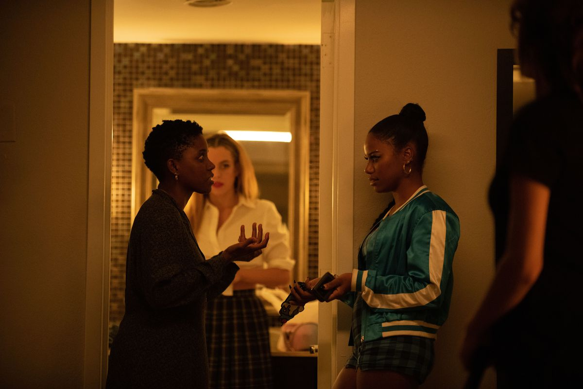 Janicza Bravo directing Taylour Paige with Riley Keough in the background during the filming of Zola