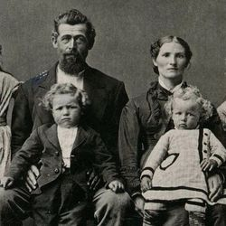 The McKay family around 1878. Future LDS Church President David O. McKay is sitting on his father's lap.