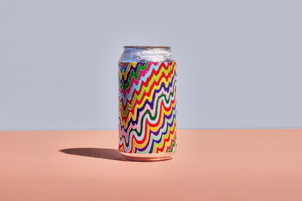 Aluminum can with rainbow-colored label design dripping down the sides.