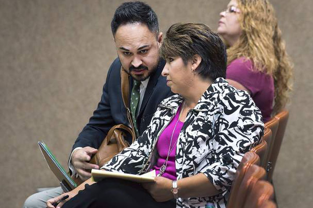 Charlotte Macaluso, right, speaks with Pueblo City Schools spokesman Dalton Sprouse on July 22, 2016. (Pueblo Chieftain file photo)