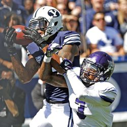 Brigham Young Cougars wide receiver Cody Hoffman (2) hauls in a touchdown over Weber State Wildcats cornerback Devin Pugh (3) during the first half as Brigham Young University plays Weber State University in football  Saturday, Sept. 8, 2012, in Provo, Utah.