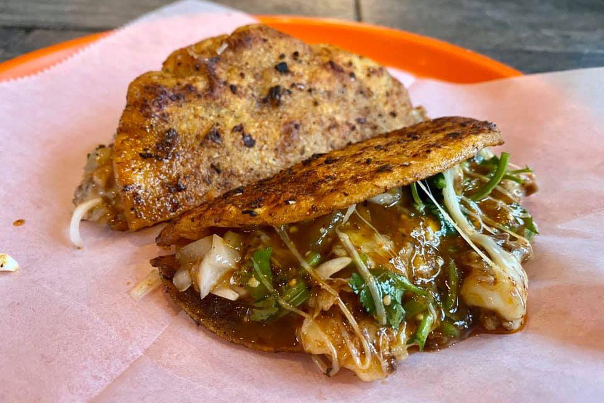 a cheesy waygu beef birria taco