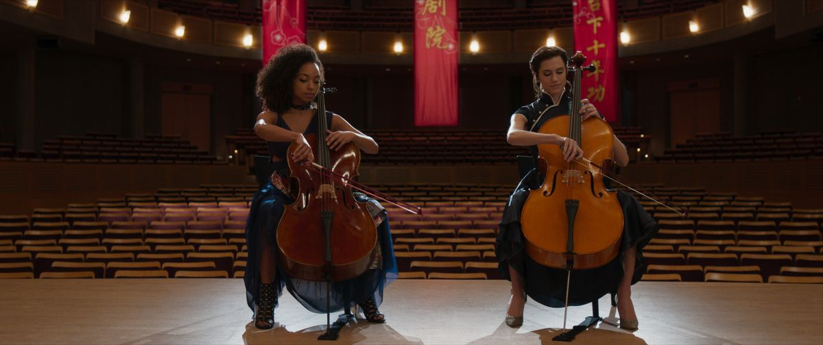Lizzie (Browning) and Charlotte (Williams) perform a cello duet.