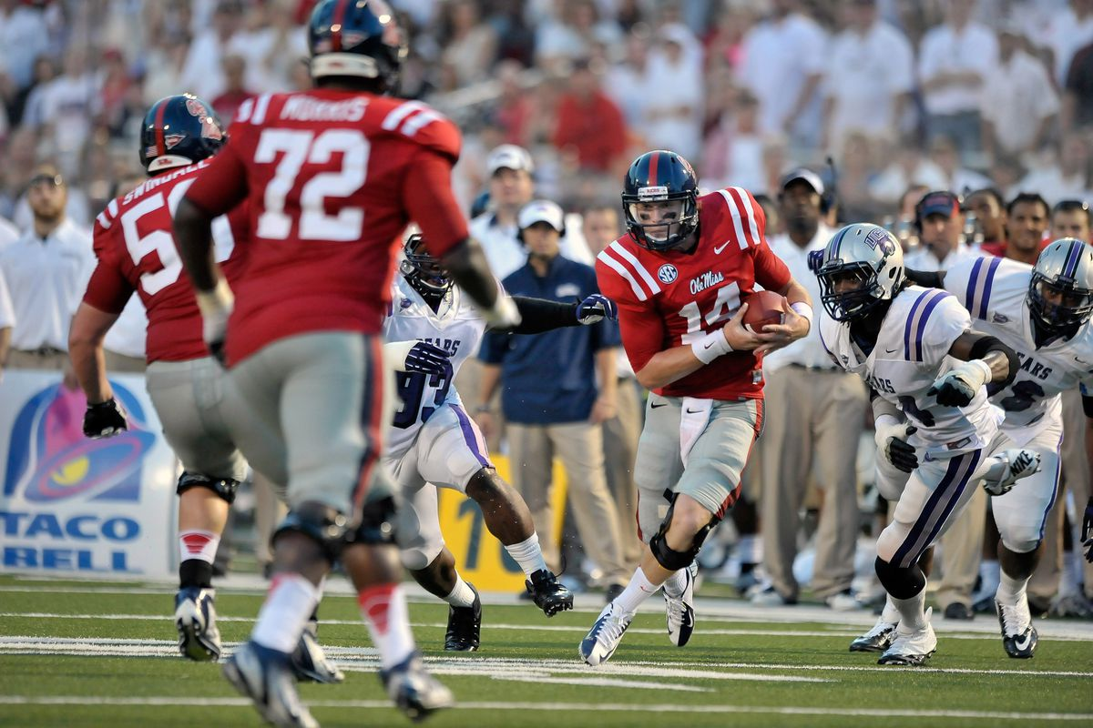 Sep 1, 2012; Oxford, MS, USA; Mississippi Rebels quarterback Bo Wallace (14) rushes against the Central Arkansas Bears during the first half at Vaught-Hemingway Stadium. Mandatory Credit: Jim Brown-US PRESSWIRE
