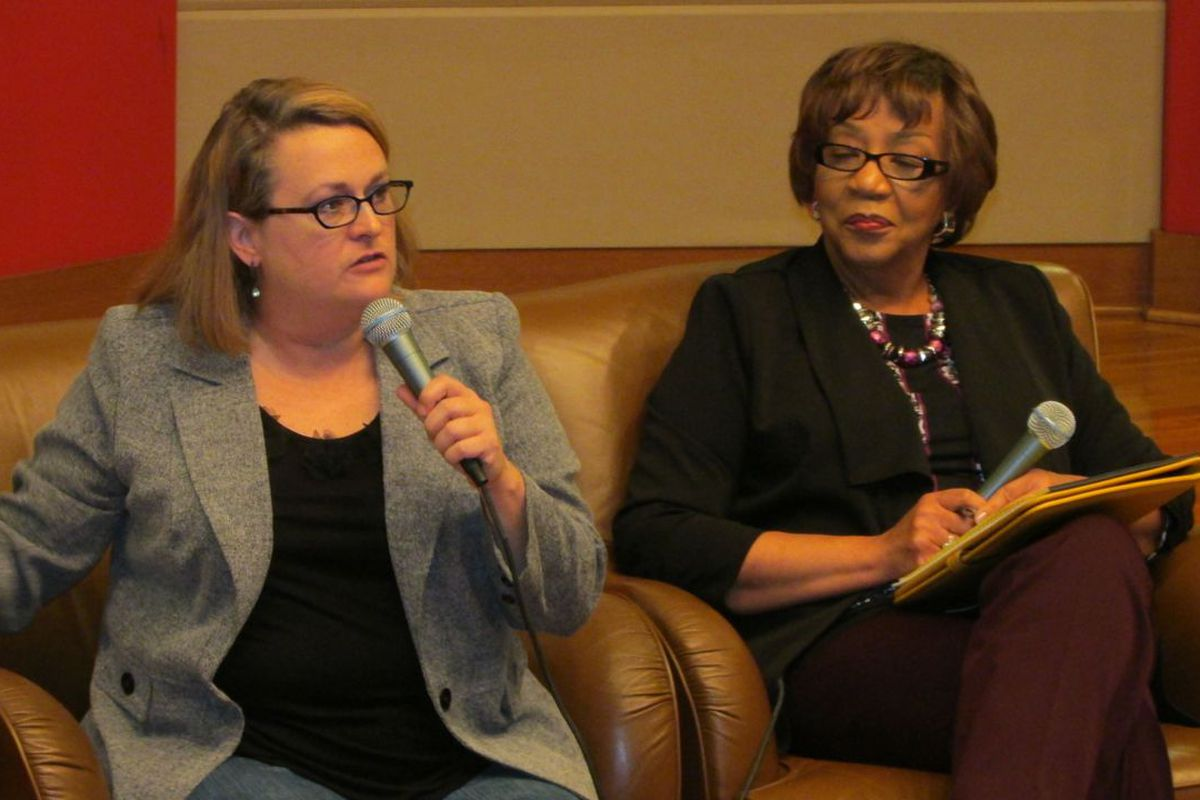 Merry Juerling, an IPS parent and member of the group Parent Power, speaks at tonight's panel discussion as Carole Craig from the Indianapolis NAACP looks on.