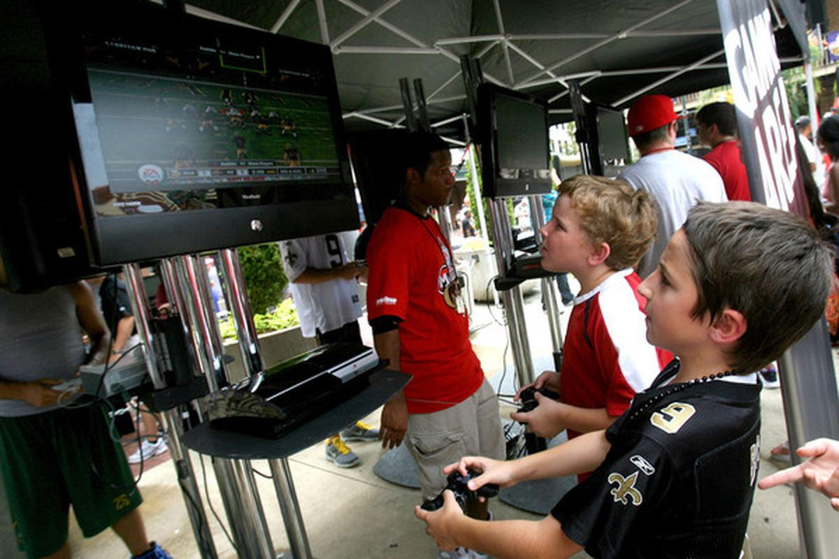 These kids will be two years older than they are here when they get the chance to play Madden 13 on that PS3 suspended in midair.
