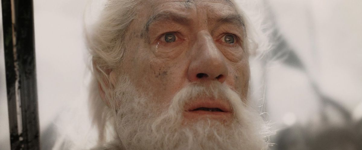 a tear falls from Gandalf's eye as Sauron's tower crumbles to the ground in Lord of the Rings: Return of the King