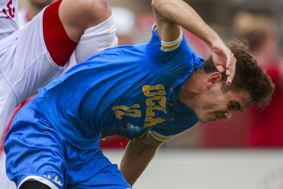 Indiana University soccer player Joe Schmidt (16) and UCLA's...
