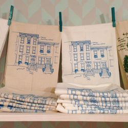 """""""The <a href=""""http://shop.girlscantell.com/product/rowhouse-tea-towel"""">Philadelphia Rowhouse Tea Towels</a> ($14) from Girls Can Tell—brand new for this season—have been flying out the door, too. They're a perfect gift for people in the neighborhood (what"""