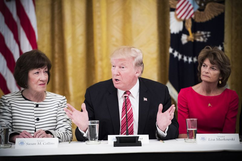 President Trump, flanked by Sen. Susan Collins (R-ME) and Sen. Lisa Murkowski (R-AK), speaks with Republican senators about health care in the East Room of the White House on, June 27, 2017.