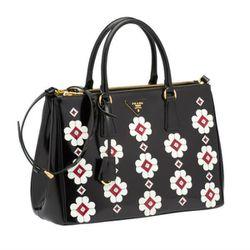"<b>Prada</b> ""Flowers"" Brushed Calf Leather Tote, <a href=""http://store.prada.com/en/US/woman/handbags/totes/B2274F_ZO6_F0NMR"">$2,500</a>"