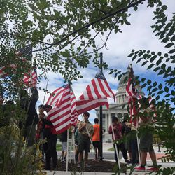 Boy Scouts help set up flags at the Utah Backs Our Blue 5k walk.
