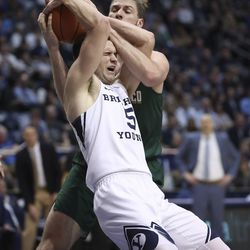 Brigham Young Cougars guard Jake Toolson (5) and San Francisco Dons center Jimbo Lull (5) fight for the ball in Provo on Saturday, Feb. 8, 2020. BYU won 90-76.