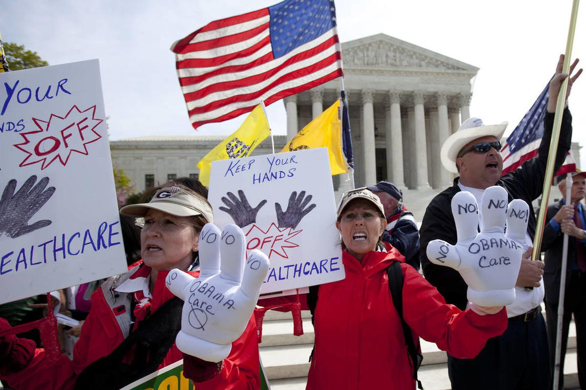 Protesters chant in front of the Supreme Court in Washington, Wednesday, March 28, 2012, as the court concludes three days of hearing arguments on the constitutionality of President Barack Obama's health care overhaul, the Patient Protection and Affordabl