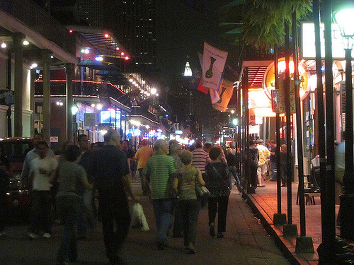 Tourists in their natural habitat: Bourbon Street.