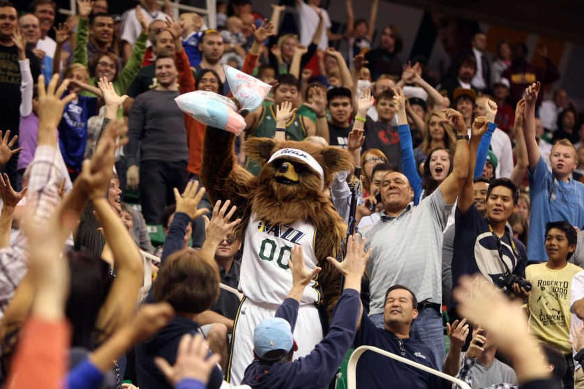 The Jazz Bear steals cotton candy from a vendor and throws it out into the crowd during the Utah Jazz scrimmage at the Energy Solutions Arena in Salt Lake City on Saturday, Oct.  6, 2012.