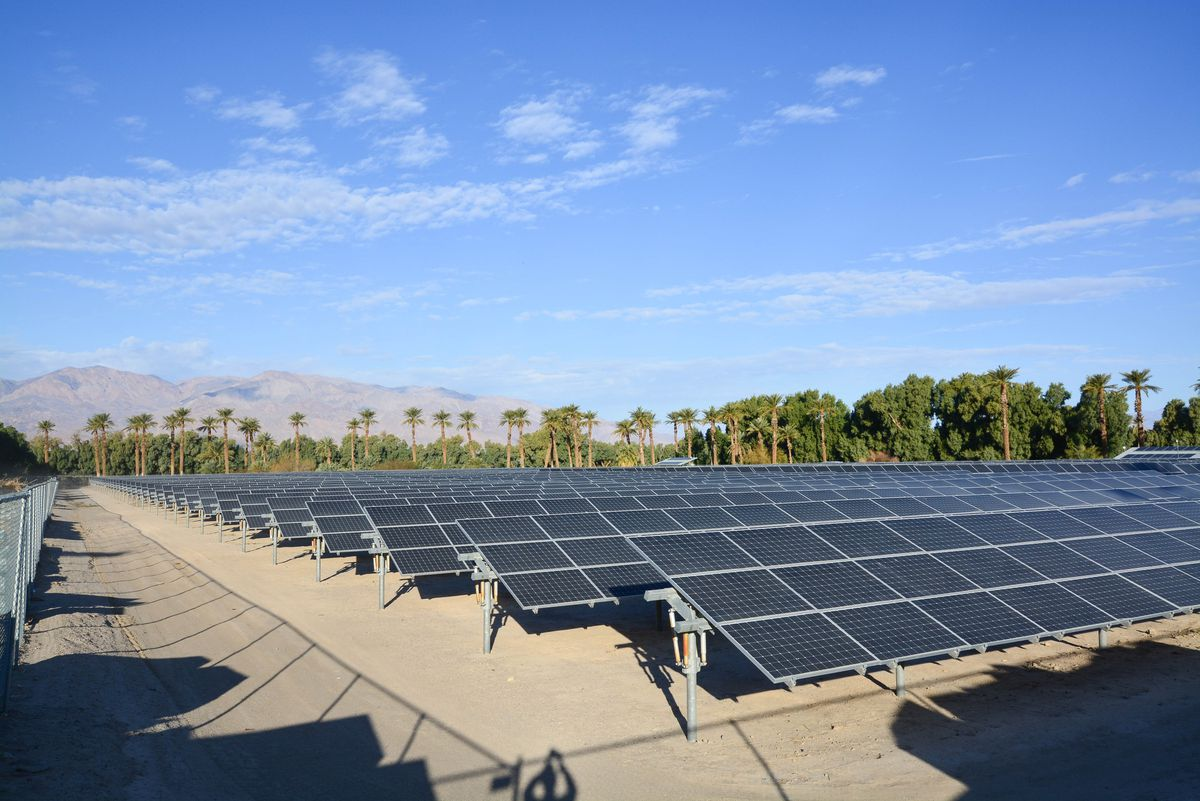 A wash of photovoltaic panels powering a desert oasis.