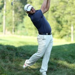 Ryan Moore hits his second shot on the 15th hole during the second round of the Deutsche Bank Championship PGA golf tournament at TPC Boston in Norton, Mass., Saturday, Sept. 1, 2012.