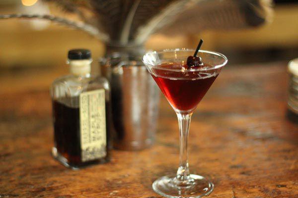 A Manhattan sitting on a bar at Black Bottle.