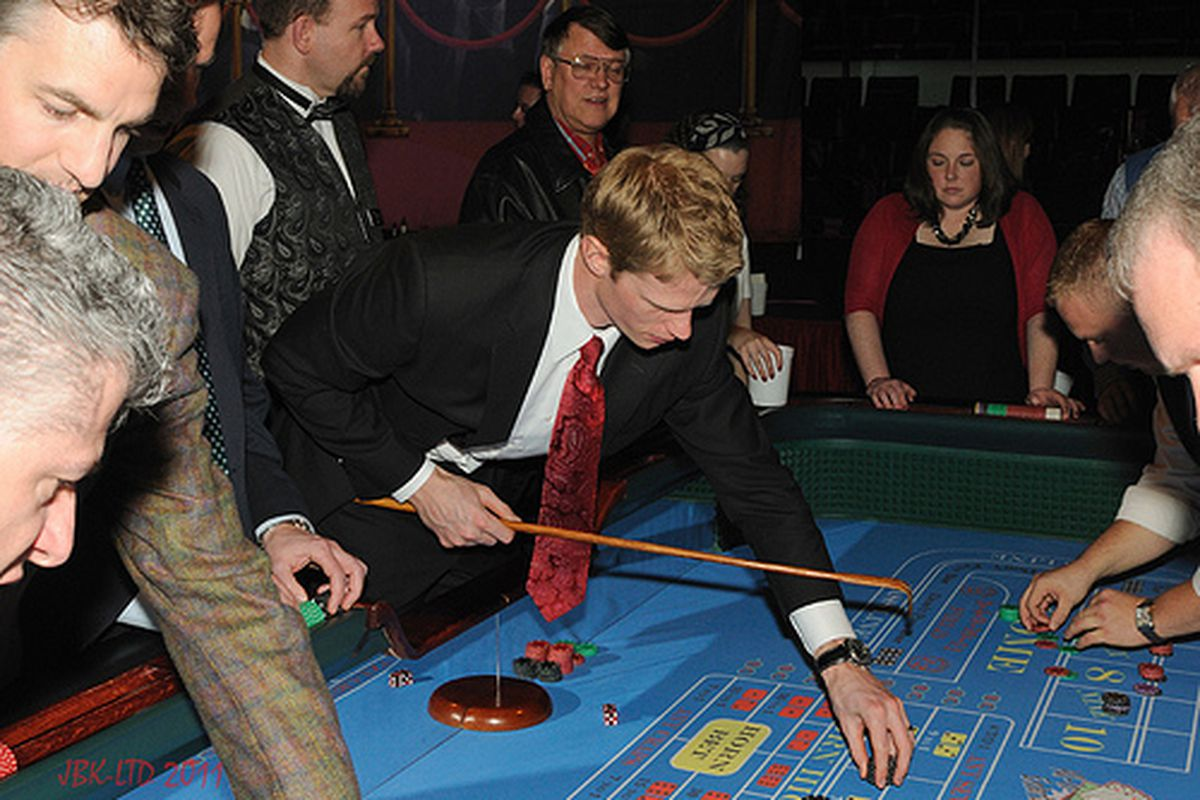 """Hurricanes Captain Eric Staal takes his duties seriously even at the craps table.  Carolina Hurricanes Casino Night, March 13, 2011.  <a href=""""http://farm6.static.flickr.com/5300/5527561034_67ed5d9191.jpg"""">Author's original photo)</a>"""
