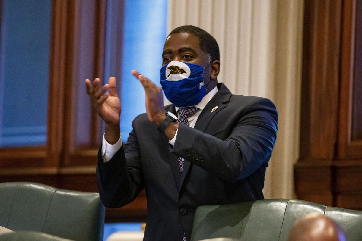 State Rep. Marcus Evans, Jr., D-Chicago, celebrates passage of a ballot question for a constitutional amendment protecting the right to unionize on Wednesday.