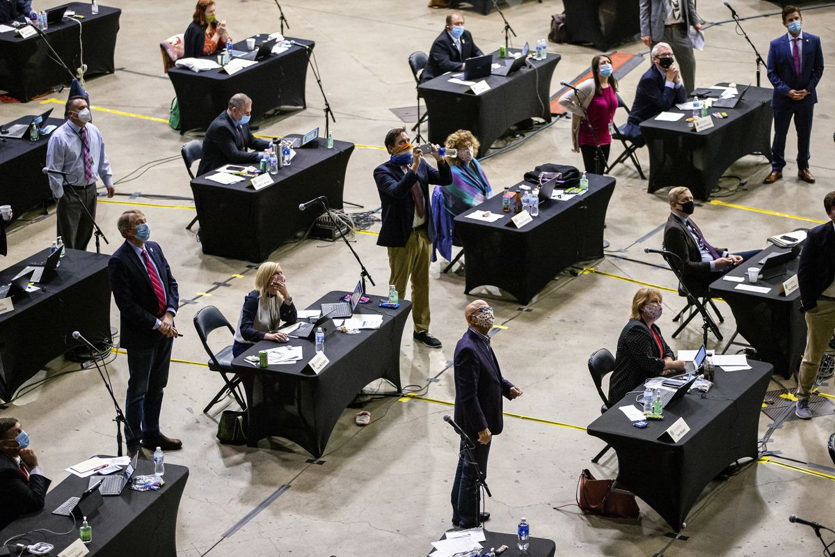 In this file photo from May 23, 2020, lawmakers watch vote totals for a Chicago casino bill at the Bank of Springfield Center in Springfield, where the Illinois House held session to allow for safe social distancing during the pandemic.