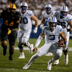 Brigham Young Cougars quarterback Jaren Hall (3) runs with the ball during an NCAA college football game against Arizona State at LaVell Edwards Stadium in Provo on Saturday, Sept. 18, 2021.