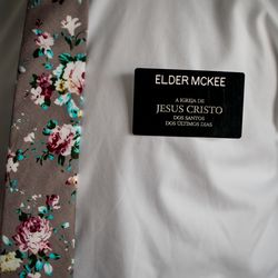Elder Tanner McKee, a missionary for The Church of Jesus Christ of Latter-day Saints, gets ready for the day by donning his name tag in Paranaguá, Brazil, on Sunday, June 2, 2019.