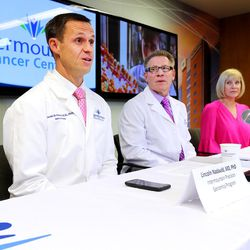 Dr. Lincoln Nadauld, executive director of Intermountain Precision Genomics, left, discusses the launch of a cutting-edge genomics breast cancer study for Utah women as Dr. Brett Parkinson, a radiologist with the Breast Care Center at Intermountain Medical Center, and Linda Warner, a breast cancer survivor, look on during a press conference in Murray on Monday, Oct. 9, 2017. The study seeks to determine whether specific blood tests that look for DNA from cancer tumors can be used to complement screening mammography to improve the way breast cancer is diagnosed.