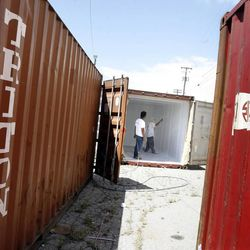 Shipping containers are painted on 700 South near 400 West in the Granary District of Salt Lake City on Thursday, May 30, 2013. Starting mid-June, the street will become a festival site Thursday and Friday evenings and Saturdays through the summer. Shipping containers will line the center of the street where local artisans and entrepreneurs will sell their work. Live music, food and a beer garden will also be part of the festival. Jewelry designers, artists, clothing designers, a bicycle shop and a cupcake maker will occupy the shipping containers.