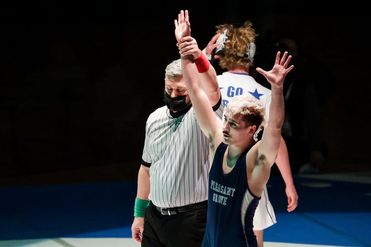 Pleasant Grove's Alex Emmer celebrates after defeating Koda DeAtley, also of Pleasant Grove, in the 138-pound finals match at the 6A wrestling state championship at Corner Canyon High School in Draper on Friday, Feb. 19, 2021.
